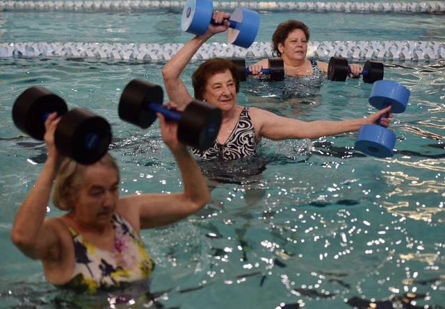 """Carol Wolosz, of Edwardsville, in the black suit at center, described the Arthritis Foundation Aquatics Program at the Wilkes-Barre YMCA as """"wonderful."""" Aimee Dilger