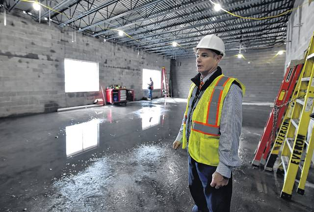 Superintendent Brian Costello talks about one of the new classroom areas, which will be divided into several rooms when complete, at Wilkes-Barre Area high school. Aimee Dilger | Times Leader