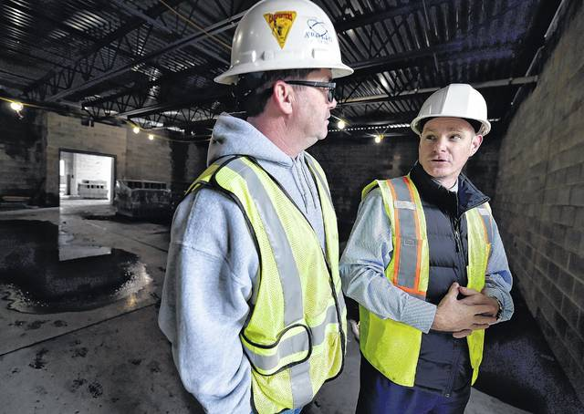 Wilkes-Barre Area School District Superintendent Brian Costello talks to Project Superintendent Jim Callahan about sections of the new high school now being temporarily sealed and heated so work can continue if winter weather gets colder. Aimee Dilger | Times Leader