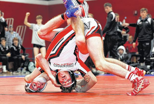 Hazleton Area's Johnny Corra (left) rides Delaware Valley's Connor Crescimanno during the 113-pound bout in the District 2 Class 3A Duals Championship held Saturday at Pittston Area High School. Crescimanno won by fall to help turn the match toward the Warriors.                                  Fred Adams | For Times Leader