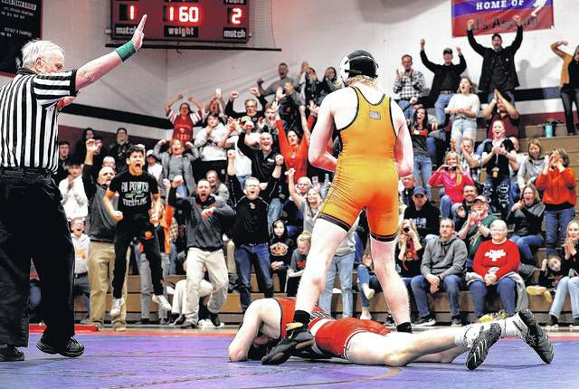 Tunkhannock senior Alex Pierce reacts as Tigers fans jump to their feet to celebrate his 2-1 decision over Lackawanna Trail's Kody Kresswell at 160 pounds that clinched the District 2 Class 2A duals championship for the team on Saturday at Pittston Area High School.                                  Fred Adams | For Times Leader