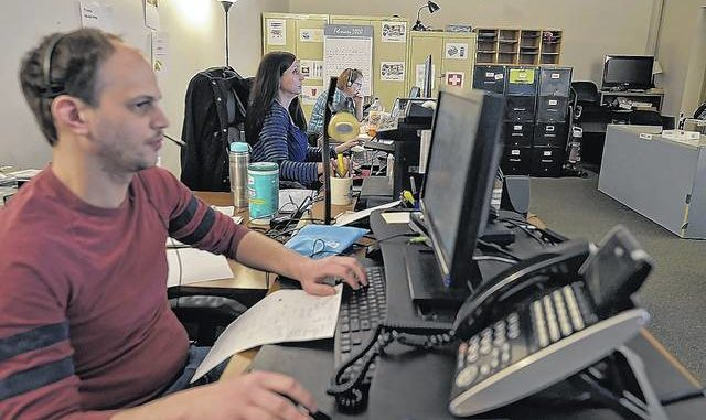 Scott Rave, Aimie Volker and Claire Holly of 211 answer telephones at the call center.                                   Aimee Dilger | Times Leader