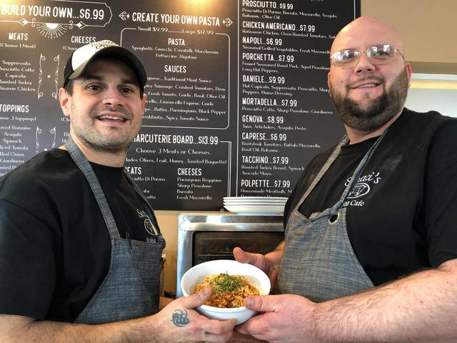 <p>Dan Matechak and Matt Drevenak hold a dish of pasta at Suraci's Italian Cafe. The eatery makes its own fresh pasta and sauces.</p>                                  <p>Roger DuPuis | Times Leader</p>