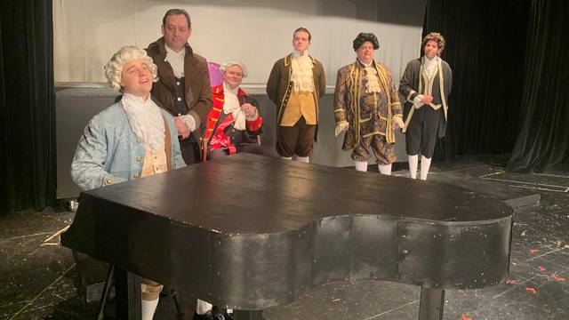 <p>The music in the PTPA production of 'Amadeus' comes from a recording, but Tim Solarek, seated at the piano, as Mozart, has rehearsed how to move his hands over the the keyboard and has researched various musical terms that come up in the script. Shown from left are cast members Tim Solarek, John Schugard, Bill Amos, James Fanjoy, Dave Zimmerman and Matt Bubel.</p>                                  <p>Submitted photo</p>