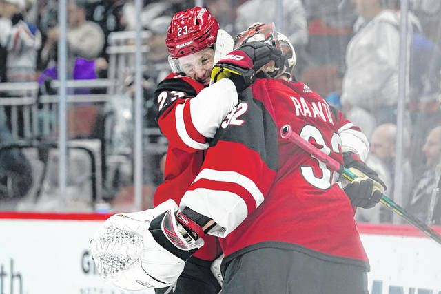 Arizona Coyotes defenseman Oliver Ekman-Larsson and Arizona Coyotes goaltender Antti Raanta celebrate after defeating the New York Islanders 2-1 during an NHL game on Monday in Glendale, Ariz.                                  AP photo