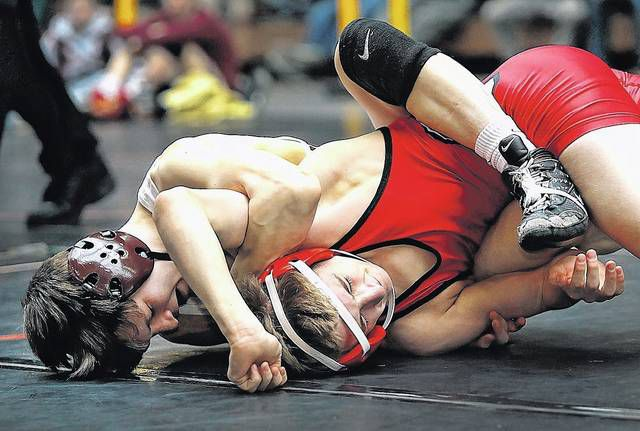 Wyoming Valley West's JJ White (top), shown here winning the 2018 District 2 title, will go for his fourth straight district crown this weekend in Class 3A.                                  Fred Adams file photo | For Times Leader