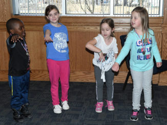 Bookworms' golf course: Young putters have fun at Pittston library