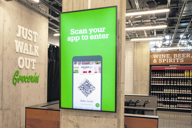 <p>A sign tells shoppers how to check in when they enter an Amazon Go Grocery store set to open soon in Seattle's Capitol Hill neighborhood.</p>                                  <p>AP photo</p>