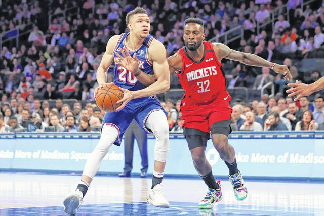 Houston Rockets forward Jeff Green (32) gets his hand caught as New York Knicks forward Kevin Knox II prepares to go up to shoot during the second half of an NBA game in New York on Monday.                                  AP photo