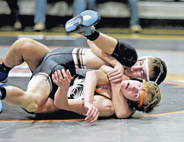 Lake-Lehman's Josh Bonomo, back, is looking to make his own legacy as one of 11 WVC wrestlers competing this week at the PIAA championships in Hershey.                                  Times Leader file photo