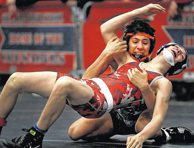 Tunkhannock's Dave Evans (back) is one of the WVC's most decorated wrestlers as he heads into his third run at states having won his second regional championship and third district crown last month.                                  Fred Adams file photo | For Times Leader