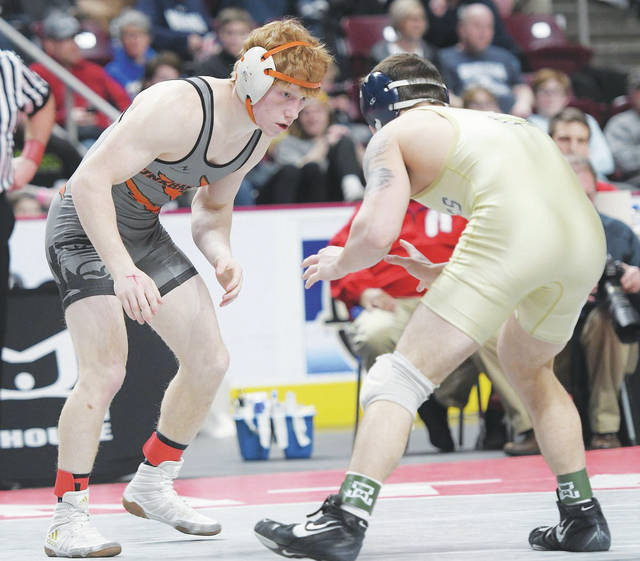 Tunkhannock senior Gavin D'Amato (left) became the first wrestler in school history to win state silver on Saturday, earning a medal along with teammate Dave Evans.                                  Dave Rosengrant | For Times Leader