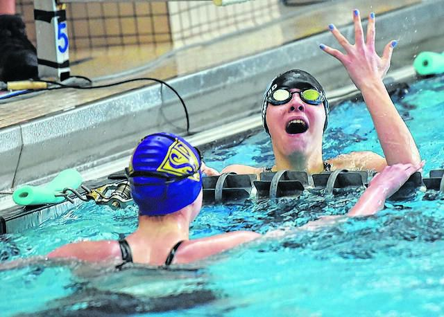Melissa Leonard of Dallas, raising her hand in celebration of setting a new District 2 record in the 200 freestyle, is seeded among the top eight competitors in three events entering the PIAA Swimming and Diving Championships this week at Bucknell University.                                  Aimee Dilger | Times Leader file photo