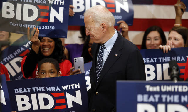 Democratic presidential candidate former Vice President Joe Biden enters a campaign event in Columbus Ohio on Tuesday. Paul Vernon   AP