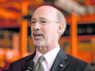 Wolf recommends suspending large gatherings, discourages non-essential travel