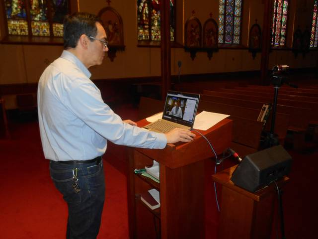 <p>Joseph Sudano, who is director of faith formation at St. Nicholas Church in Wilke-Barre, sets up the digital recording equipment before the Mass.</p> <p>Mary Therese Biebel | Times Leader</p>