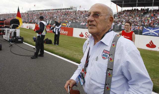 FILE - In this file photo dated Sunday, June 21 2009, Stirling Moss, the legendary British Racing driver attends the British Formula One Grand Prix at the Silverstone racetrack, in Silverstone, England. Stirling Moss has died at the age of 90.
