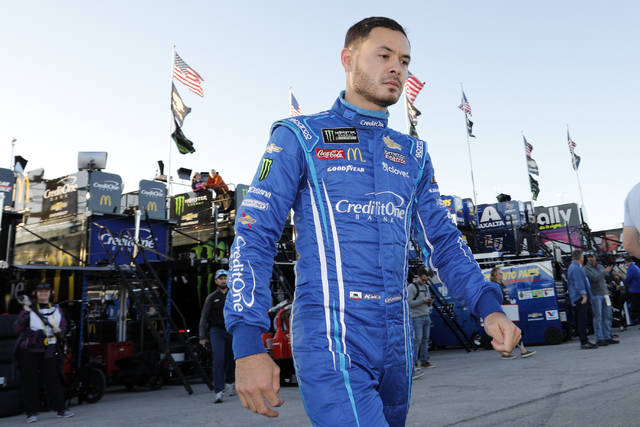 <p>NASCAR driver Kyle Larson is being suspended without pay by Chip Ganassi Racing after using a racial slur during a virtual race on Sunday.</p> <p>Colin E. Braley | AP file photo</p>