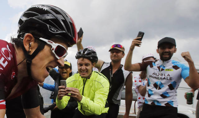 The Tour de France is known for fans packed along the routes to cheer, raising concerns during the coronavirus pandemic. Christophe Ena | AP file photo