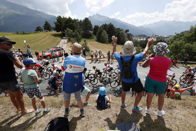 <p>Swarms of fans can clog city streets during stretches of the Tour de France, one reason it won't be able to start in its traditional late-June window.</p>