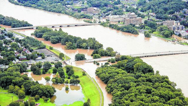 Overseers of the Wyoming Valley Levee — shown holding back the Susquehanna River in Wilkes-Barre in 2011 — are fighting to make sure property owners receive full flood insurance rate credit from the flood-control system.                                  File photo