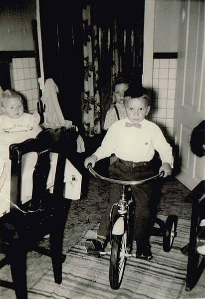 <p>Little Billy O'Boyle rides his new bike through his kitchen during his 6th birthday celebration.</p>