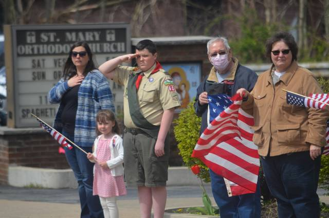 <p>Boy Scout Hayden Fleegle, 13, of Dorrance Township, salutes the passing funeral procession of World War II veteran Dalton Drake as he stands along South Main Street in Wilkes-Barre with his mother, Rachel Fleegle; sister Seraphina Fleegle, and grandparents Herb and Beverly Cruikshank of Mountain Top. The funeral procession was on its way to Oak Lawn Cemetery in Hanover Township.</p>                                  <p>Mark Guydish | Times Leader </p>