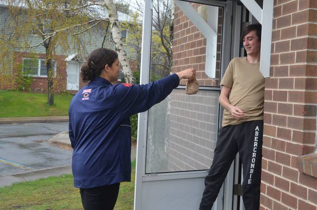 <p>Coughlin High School senior Daniel Driya opened the door of his home to find his teacher, Genelle Hoban-Sedon, had brought him a doughnut and inspirational card.</p>                                  <p>Mark Guydish | Times Leader </p>