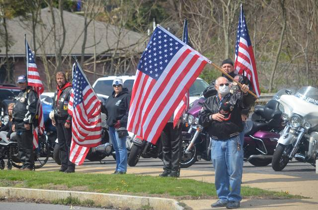 <p>The patriotic scene last Saturday included many people who carried flags and lined the streets to honor World War II veteran Dalton Drake as his funeral procession passed.</p>                                  <p>Mark Guydish | Times Leader </p>