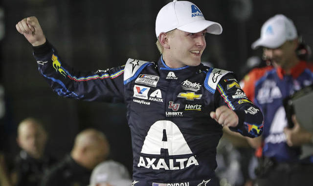 FILE - In this Feb. 13, 2020, file photo, William Byron celebrates in Victory Lane after winning the second of two NASCAR Daytona 500 qualifying auto races at Daytona International Speedway in Daytona Beach, Fla. Byron has won NASCAR's iRacing event at virtual Dover International Speedway. It is Byron's third victory in the last four iRacing events created to provide NASCAR content during the coronavirus pandemic. AP photo