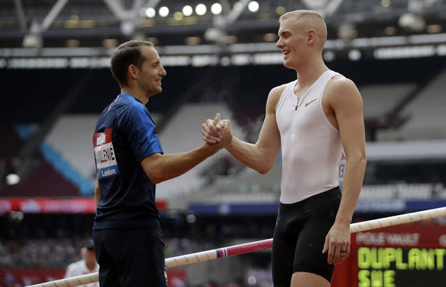 <p>In this July 21, 2018, file photo, second placed Renaud Lavillenie of France, left, shakes hands with winner Sam Kendricks at the men's pole vault event at the IAAF Diamond League athletics meeting in London.</p> <p>AP photo</p>