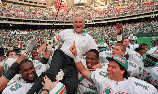 Dolphins coach Don Shula is carried on his team's shoulders after his record 325th victory after beating the Eagles in Philadelphia in 1993. Shula died Monday at his home in South Florida. George Widman | AP file photo