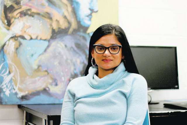 <p>Taneeza Islam, who runs an advocacy organization called South Dakota Voices for Peace, poses at the offices of the organization in Sioux Falls. Islam organized a letter to Gov. Kristi Noem asking her to meet with Smithfield workers as the plant reopens. She said the governor's comments laid a 'foundation' for Smithfield to blame workers for the outbreak.</p> <p>AP photo</p>