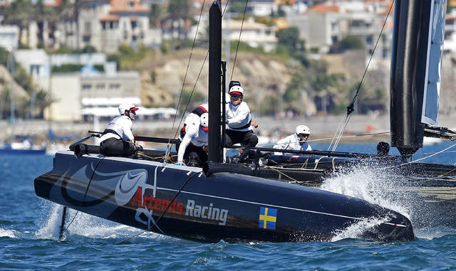 In this Aug. 7, 2011 file photo, Sweden's Artemis Racing AC45, skippered by Terry Hutchinson, left, from the United States, sails during the second day of racing at the America's Cup World Series in Cascais, near Lisbon. America's Cup teams are returning to the water in varying degrees nearly two months after the coronavirus pandemic forced the shutdown of what would have been an impressive global road show. AP photo
