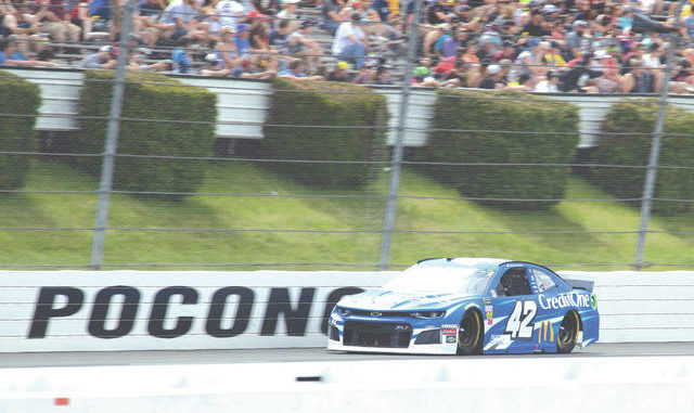 Kyle Larson drives down the front stretch during a NASCAR Cup Series race at Pocono Raceway last June. The raceway has announced it will host three more high school graduations in June. Matt Slocum | AP file photo