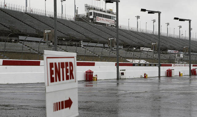 Safety protocols will keep Darlington Raceway empty for Sunday's Cup Series race, with no fans in the stands and staffers kept to a minimum. Terry Renna | AP file photo