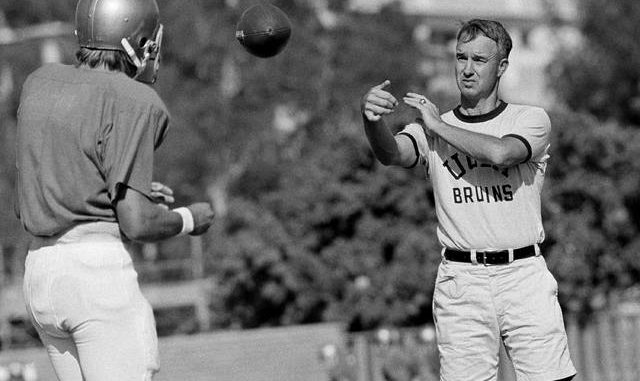 In this Sept. 13, 1972, file photo, UCLA quarterback Mark Harmon, left, son of former Michigan Heisman Trophy winner Tom Harmon, works out with coach Pepper Rodgers, right, in Los Angeles. Rodgers, a colorful personality who helped Georgia Tech to an unbeaten season as a player in 1952 and went on to coach the Yellow Jackets as well as Kansas, UCLA and in the United States Football League, died Thursday at the age of 88. AP photo