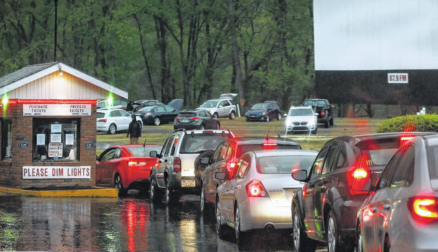 <p>Cars line up to get tickets at the Garden Drive-In in Hunlock Creek on Friday. It was the first time the drive-in was open this year.</p> <p>Fred Adams | For Times Leader</p>