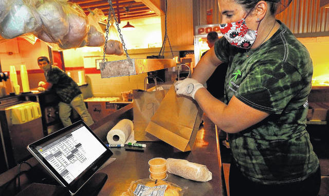 Stephanie Dombrowski fills an online food order at the Garden Drive-In concession stand Friday night. Allowing moviegoers to order their snacks online was one of the changes the drive-in made due to the COVID-19 pandemic. Fred Adams | For Times Leader
