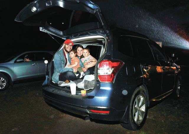 """<p>The Williams family from Swoyersville came to the Garden Drive-In's opening night to see """"Trolls World Tour."""" From left: Travis, Leia, Espy and Cooper.</p> <p>Fred Adams 