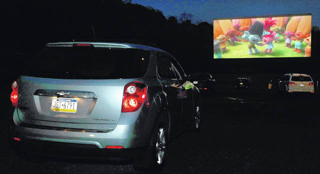 "<p>Moviegoers enjoy ""Trolls World Tour"" at the Garden Drive-In in Hunlock Creek on Friday night.</p>"