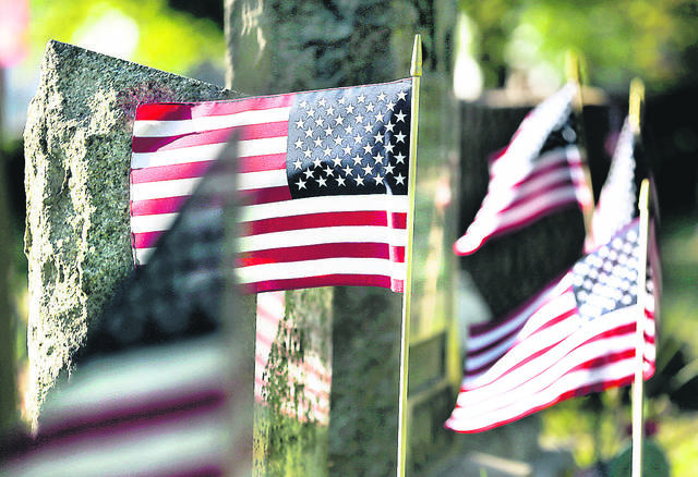 <p>Flags wave in the breeze at the Forty Fort Cemetery on Thursday after new flags were placed in front of grave stones in preparation for Memorial Day.</p> <p>Fred Adams | For Times Leader</p>