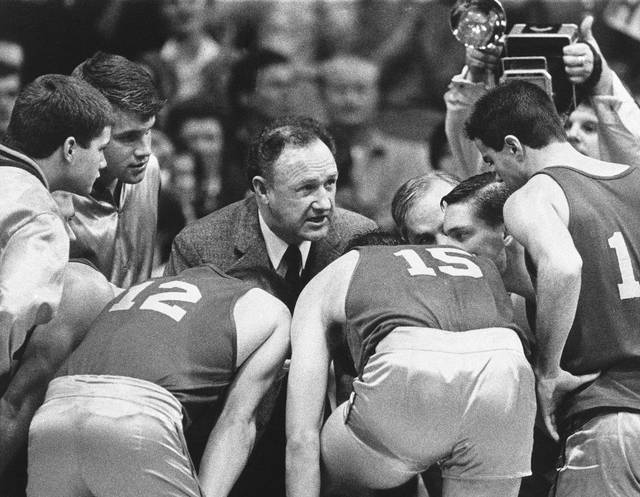 <p>Actor Gene Hackman gives fictional Hickory High basketball players instructions during filming of the final game of the movie 'Hoosiers' at Hinkle Fieldhouse on the Butler University campus in Indianapolis. 'Hoosiers' was voted the No. 1 sports movie of all time by the sports staff of The Associated Press.</p>