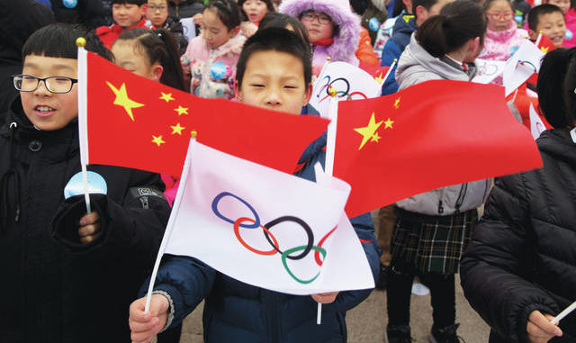 A child waves a Chinese national flag and an Olympic flag during a ceremony to mark the arrival of the Olympic flag and start of the flag tour for the Winter Olympic Games Beijing 2022 at a section of the Great Wall of China on the outskirts of Beijing. Uncertainty surrounds how the postponed Tokyo Olympics will be held next year in the midst of the coronavirus. The same questions permeate three mega-events that will be staged in China within a year after the Tokyo Games close. AP photo