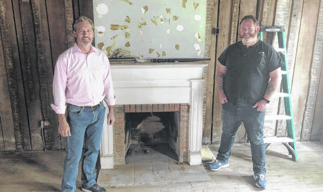 Tony Brooks, left, and Jonathan Edwards are seen in the front room of the historic Zebulon Butler House in Wilkes-Barre. Brooks, as director of the Wilkes-Barré Preservation Society and curator of the house, has teamed up with Edwards, of Jonathan Edwards - 570 Drone, to produce a series of videos about the city's architectural and social heritage, called 'Diamond City: Trail of History.' Roger DuPuis | Times Leader