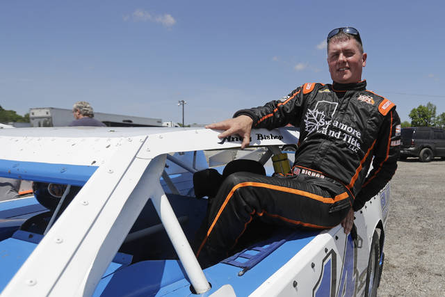 <p>Andy Bishop climbs out of his car following a practice session at Gas City I-69 Speedway on Sunday in Gas City, Ind. On a day usually reserved for IndyCar's crown jewel race, Gas City I-69 Speedway an hour's north of Indianapolis had a handful of cars on a short dirt track.</p>