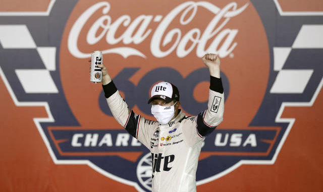 Brad Keselowski celebrates after winning the NASCAR Cup Series race at Charlotte Motor Speedway early Monday in Concord, N.C. AP photo
