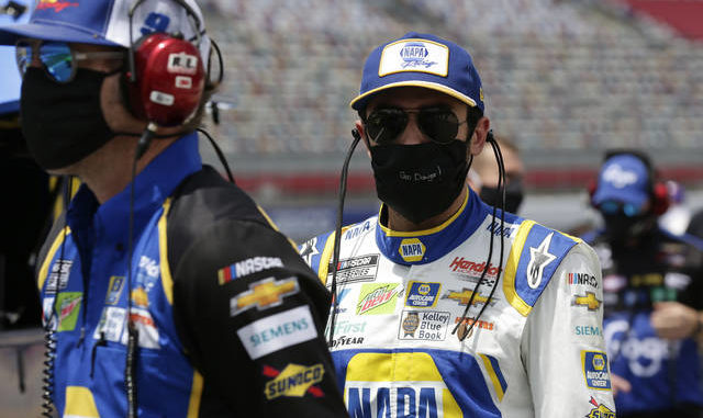 Driver Chase Elliott walks along pit road during qualifying prior to a NASCAR Cup Series race at Charlotte Motor Speedway Sunday, May 24, 2020, in Concord, N.C.