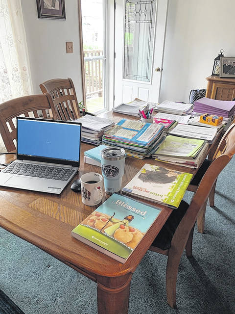 <p>These days, a classroom looks more like a kitchen table. This is Janine Halchak's setup for teaching students at St. Nicholas-St. Mary's School remotely.</p>