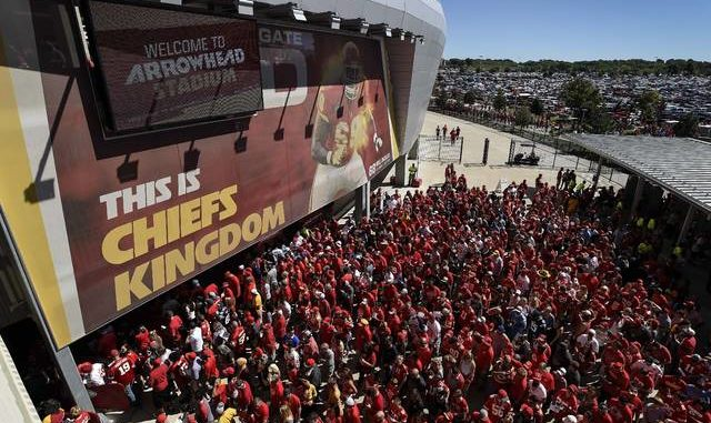 In this Sept. 11, 2016, file photo, Kansas City Chiefs fans line up to enter Arrowhead Stadium before their NFL football game against the San Diego Chargers in Kansas City, Mo. The crippling coronavirus pandemic has brought the entire world — including the sports world — to a standstill, and it shows no sign of going away anytime soon. That has left fans, stadium workers, team owners, sponsors and yes, even players, wondering what life will be like when games finally resume.